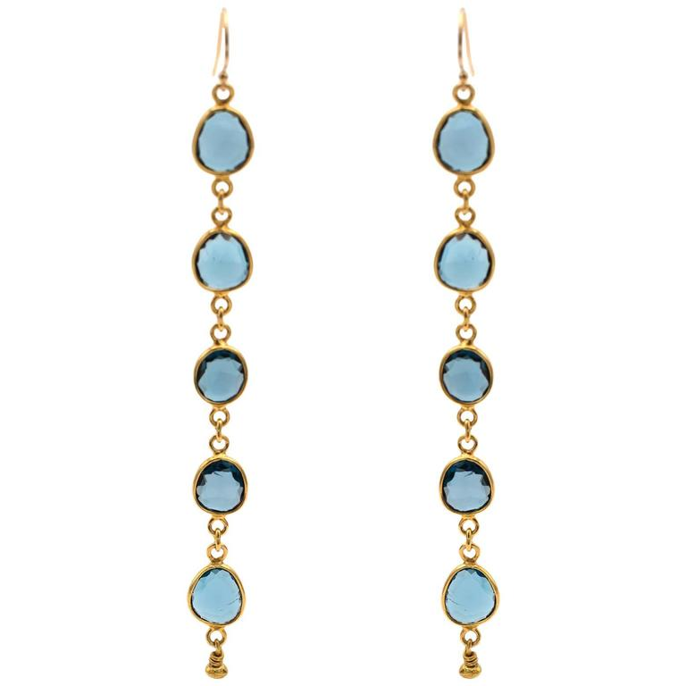 Long Blue Topaz Gold Earrings with Ten Total Round Faceted Stones