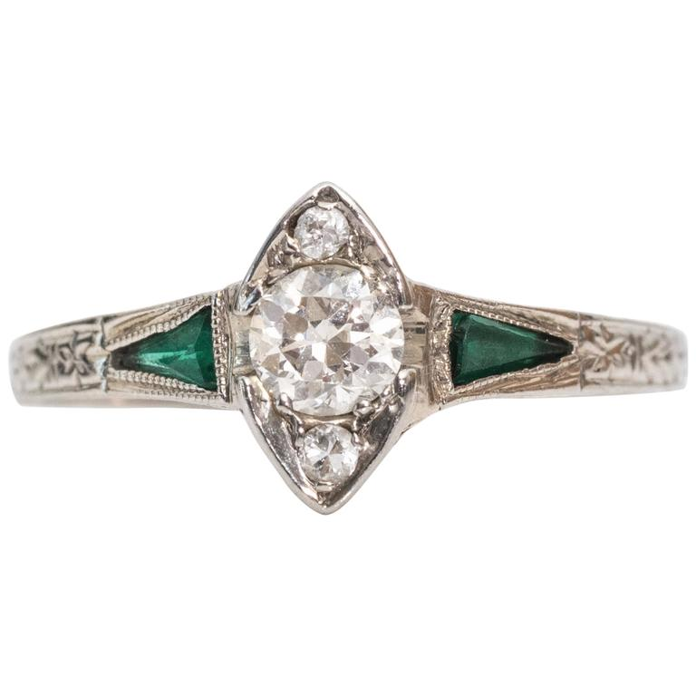1915 Art Deco .20 Carat Old European Diamond Emerald 18 Karat White Gold Ring