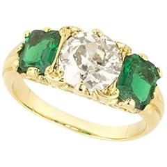 Classic English Emerald Diamond Gold Three-Stone Engagement Ring