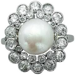 1910s French Natural Pearl Diamond and Platinum Ring