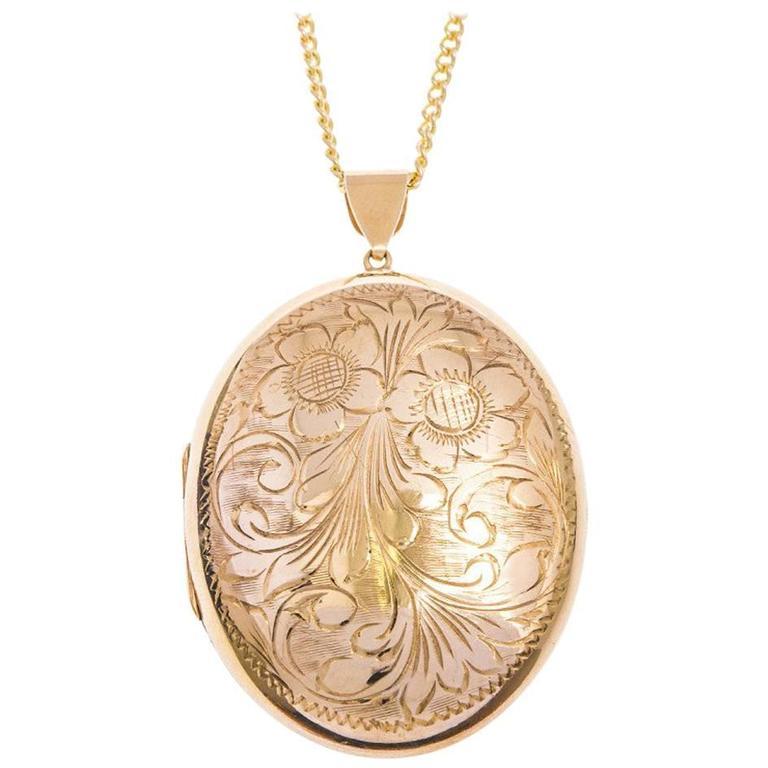 Vintage 9 carat gold large oval locket at 1stdibs vintage 9 carat gold large oval locket for sale aloadofball Images