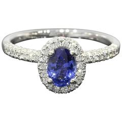 White Gold Oval Sapphire and Diamond Certified Halo Engagement Ring