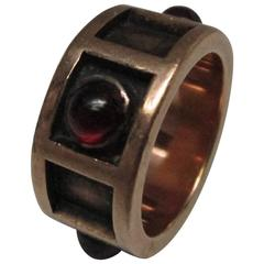 Arts and Crafts Garnet Cabochon Gold Band Ring