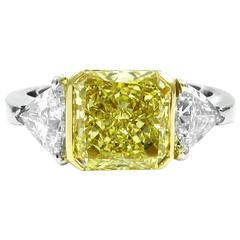 GIA Certified 3.23 Carat Fancy Yellow and White Diamond Gold Three-Stone Ring