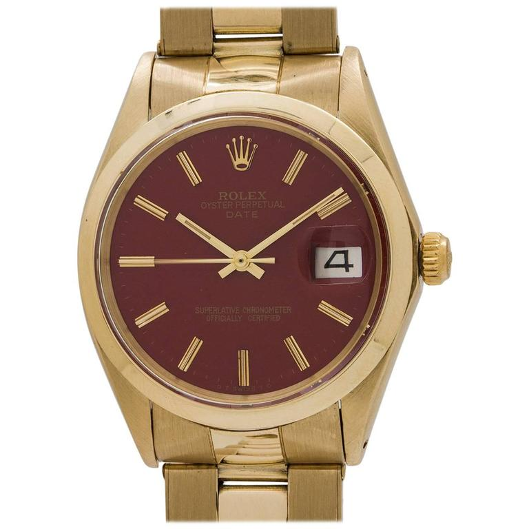 Rolex Yellow Gold Oyster Perpetual Date Brick Red Wristwatch circa 1969 For Sale