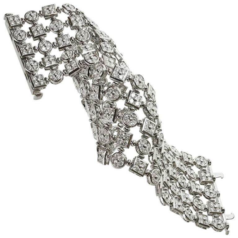 This fabulous flexible wide bracelet features four rows of round and square links set with round brilliant-cut diamonds of an estimated 24.0 carats. This magnificent 18k white gold bracelet feels and sparkles like a dream! Made in Italy circa 2000s.