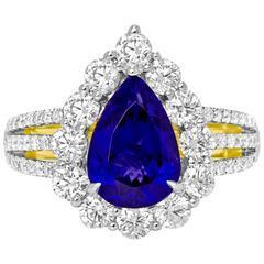 Tanzanite Diamond Two Color Gold Halo Ring