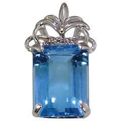 Brilliant Emerald Cut Sky Blue Topaz Set in Ornate Sterling Silver Pendant