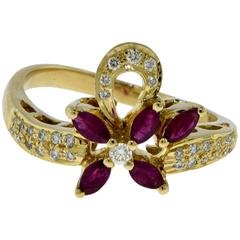 Van Cleef & Arpels Diamond and Ruby Flower Ribbon Yellow Gold Ring