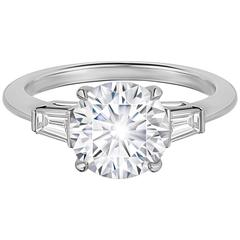 2.20 carat round brilliant diamond 2 baguettes Three Stone Engagement Ring