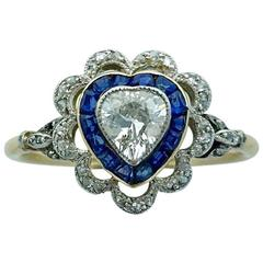 French 1900s Heart Shape Diamond Calibrated Sapphire Gold Platinum Ring