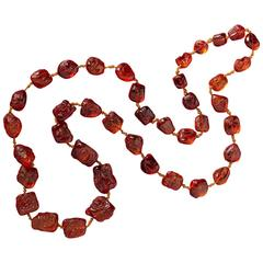 An Important Necklace of Chinese Carved Amber Beads
