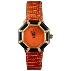 Delaneau in 18 Karat Yellow Gold, Onyx, Diamonds and Coral Dial, circa 1980
