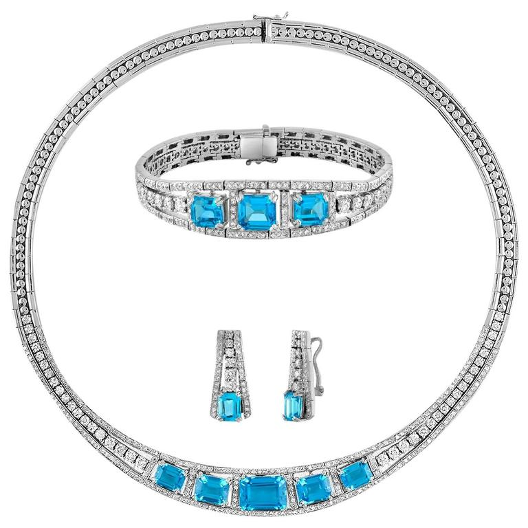 41.20 Carat Blue Topaz And Diamond Gold Necklace Earrings Bracelet Set For Sale