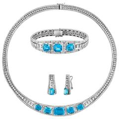 12.83 Carat Diamond and 41.20 Carat Blue Topaz Gold Three-Piece Set