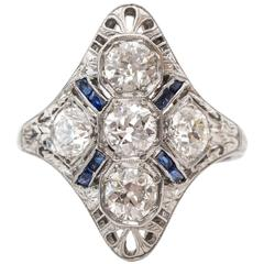 1920s Art Deco 1.50 Carat Ornate Old Mine Diamond and Sapphire Shield Ring