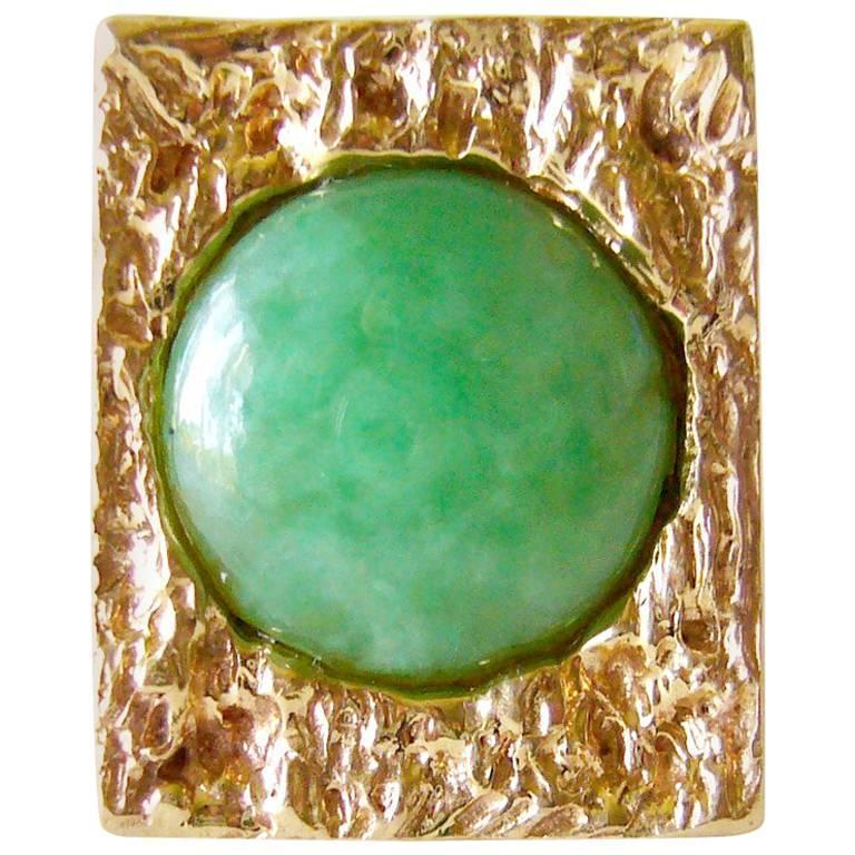 Heavy, 14k gold ring with jade cabochon, circa 1960's.  Ring is a finger size 5.75 to 6 and could easily be resized if need be.  An unconventional alternate to a modern day wedding or engagement ring. Suitable for a man or woman.  Signed 14k and in