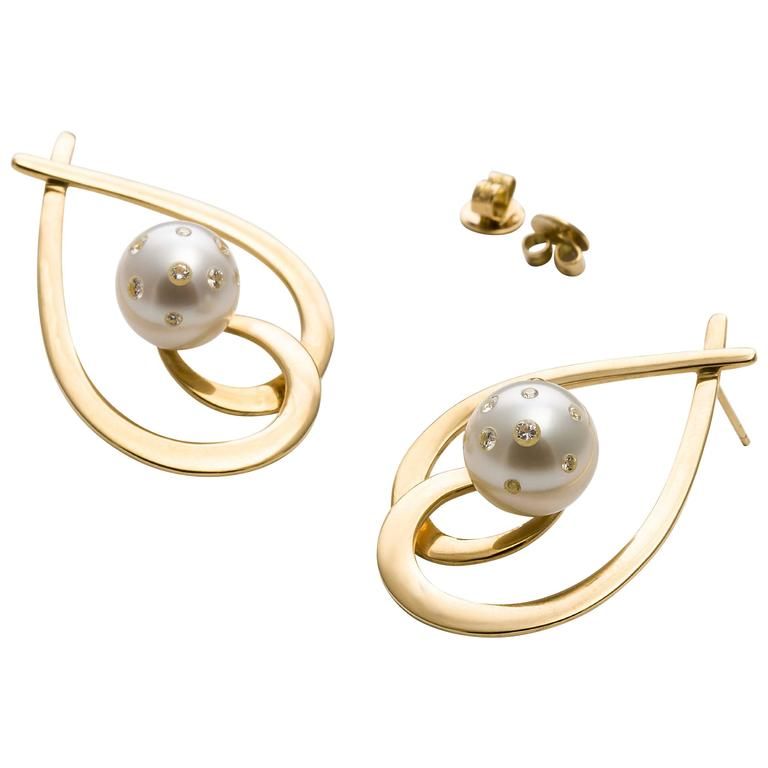 Contemorary design bring the Aria earrings alive with stunning South Sea pearls embellished with white brilliant cut diamonds.                Aria Design (as the pair seen on the banner model) are 18 carat yellow gold with a highly polished finish