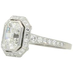 Hancocks  1.82 carat Emerald-cut diamond  ring with a diamond-set halo