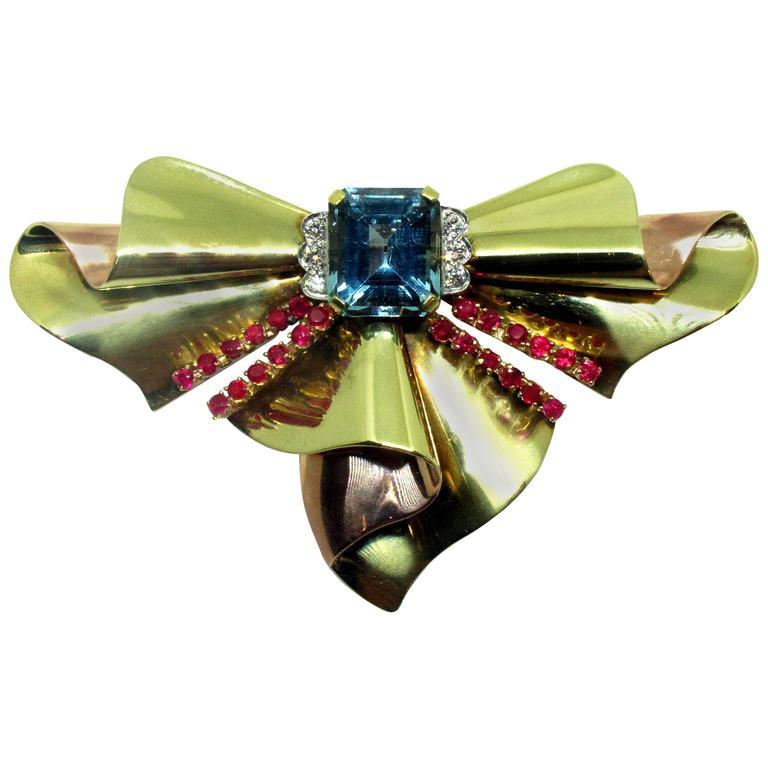 Tiffany & Co. Retro Aquamarine Ruby Diamond Gold Bow Brooch