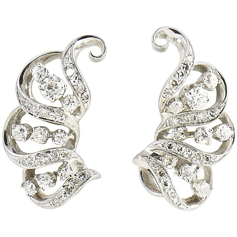 1950s Diamond Ribbon Swirl Platinum Cocktail Earrings