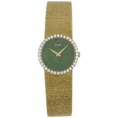 Piaget Ladies Yellow Gold Jade Dial Diamond Bezel Wristwatch