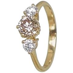 Exquisite Champagne and White Diamond Gold Three-Stone Engagement Ring