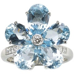 Blue Pear-Shaped Topaz 6.34ct Diamond 0.30ct White Gold Platinum Flower Ring