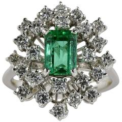 1.70 Carat Natural Colombian Emerald 1.50 Carat Diamond Vintage Cluster Ring