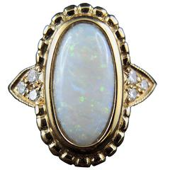 Opal and Diamonds Ring, Yellow Gold, France