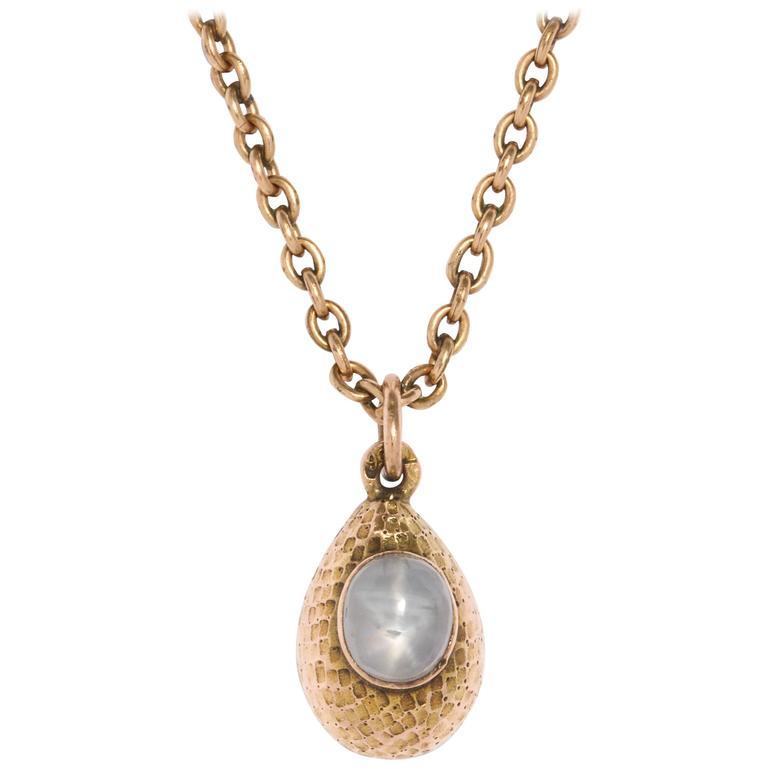 Rare Russian Textured Gold and Star Sapphire Egg Pendant, circa 1900