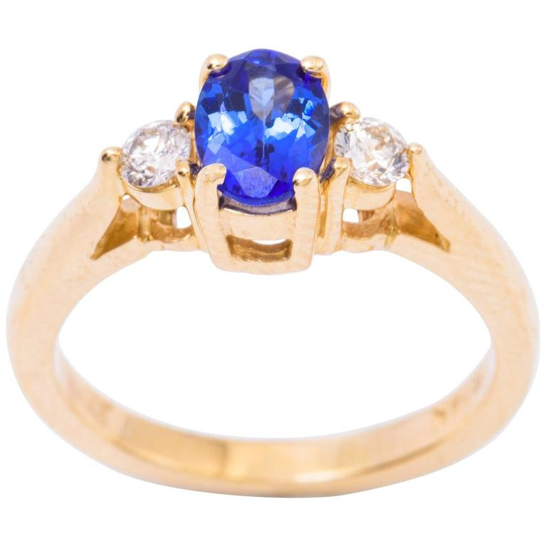 Oval Tanzanite Diamond Gold Three-Stone Engagement Ring For Sale