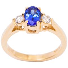 Oval Tanzanite Diamond Gold Three-Stone Engagement Ring