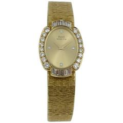 Piaget Ladies Yellow Gold Diamond Dial Diamond Bezel Wristwatch