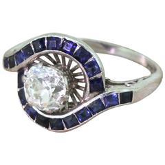 Mid-Century 1.43 Carat Old Cut Diamond and Calibré Cut Sapphire Ring