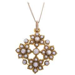 Edwardian Seed Pearl Gold Quatrefoil Daisy Pendant