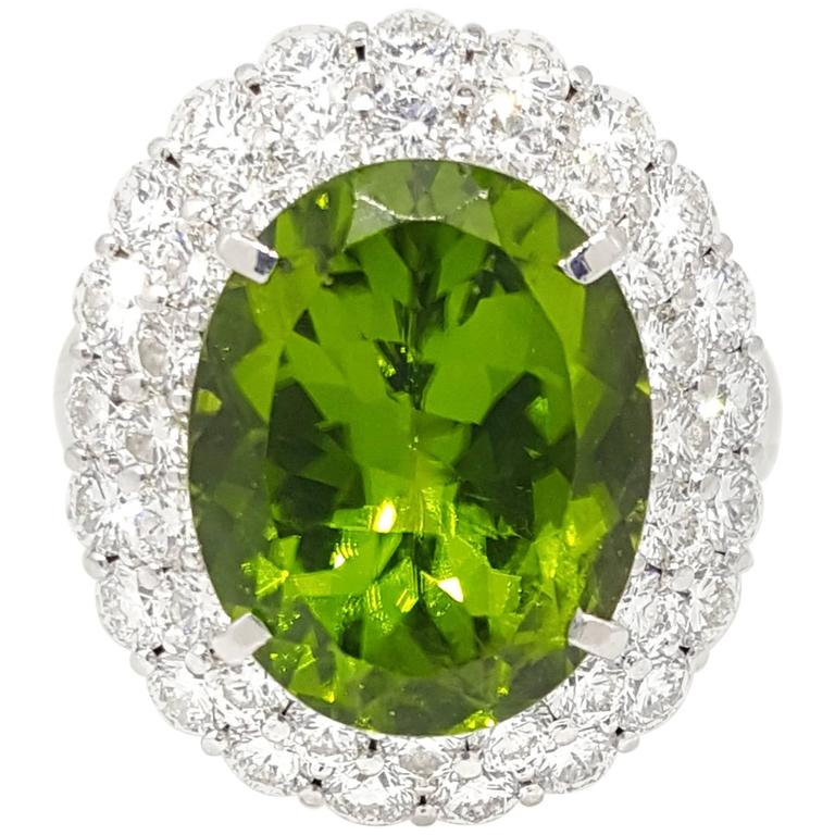 Large Oval Peridot Diamond Platinum Halo Ring For Sale