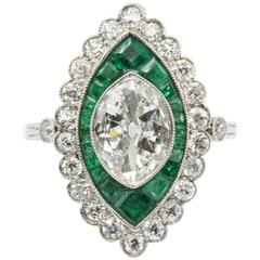 Antique 1.05 Carat Moval Diamond Emerald Halo Ring,