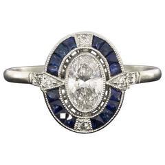 Oval Diamond Sapphire Platinum Halo Engagement Ring