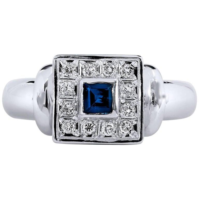 princess cut blue sapphire pave white gold ring