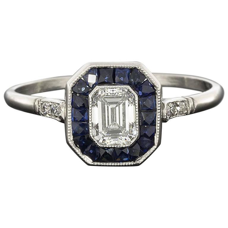 emerald cut sapphire platinum halo engagement ring
