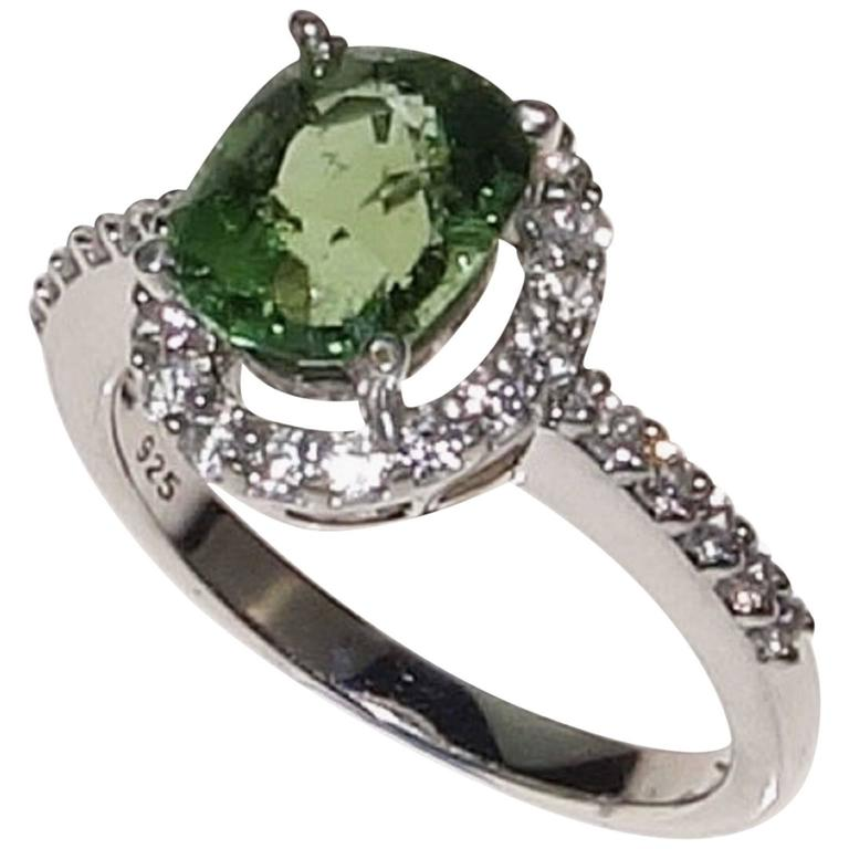 Glowing Oval Green Tourmaline Halo Set in Sterling Silver
