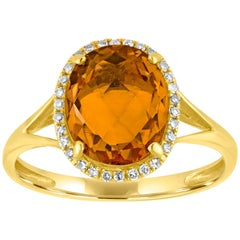 Oval Cut 2.47 Carats Citrine and Diamond Halo Gold Ring