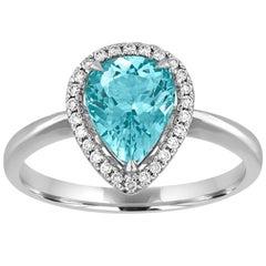 Pear Shape 1.20 Carat Blue Topaz and Diamond Halo Gold Ring