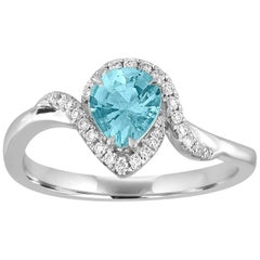 Pear Shape 0.62 Carats Blue Topaz and Diamond Twist Halo Gold Ring