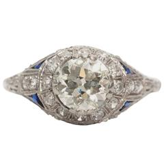 1900s Platinum Diamond Ring with Trillion Cut Blue Sapphire Accents