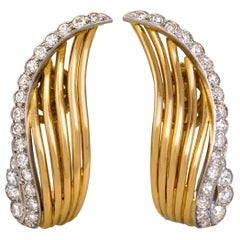 1940s Cartier Diamond Platinum Gold Wing Earclips