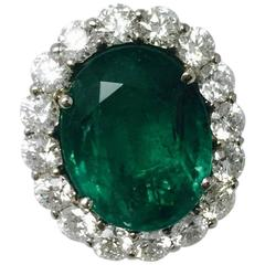Captivating Colombian Emerald White Gold Framed by White Diamonds