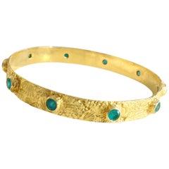 18 Karat Gold Textured Bangle with Paraiba Tourmalines