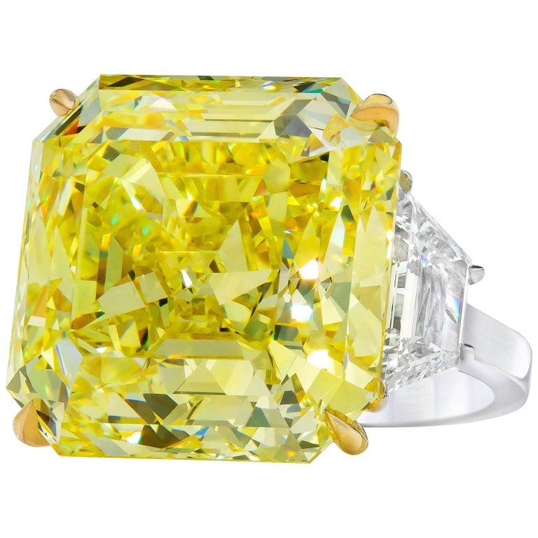 GIA Certified 30.02 Carat Fancy Intense Yellow Diamond Three-Stone Ring